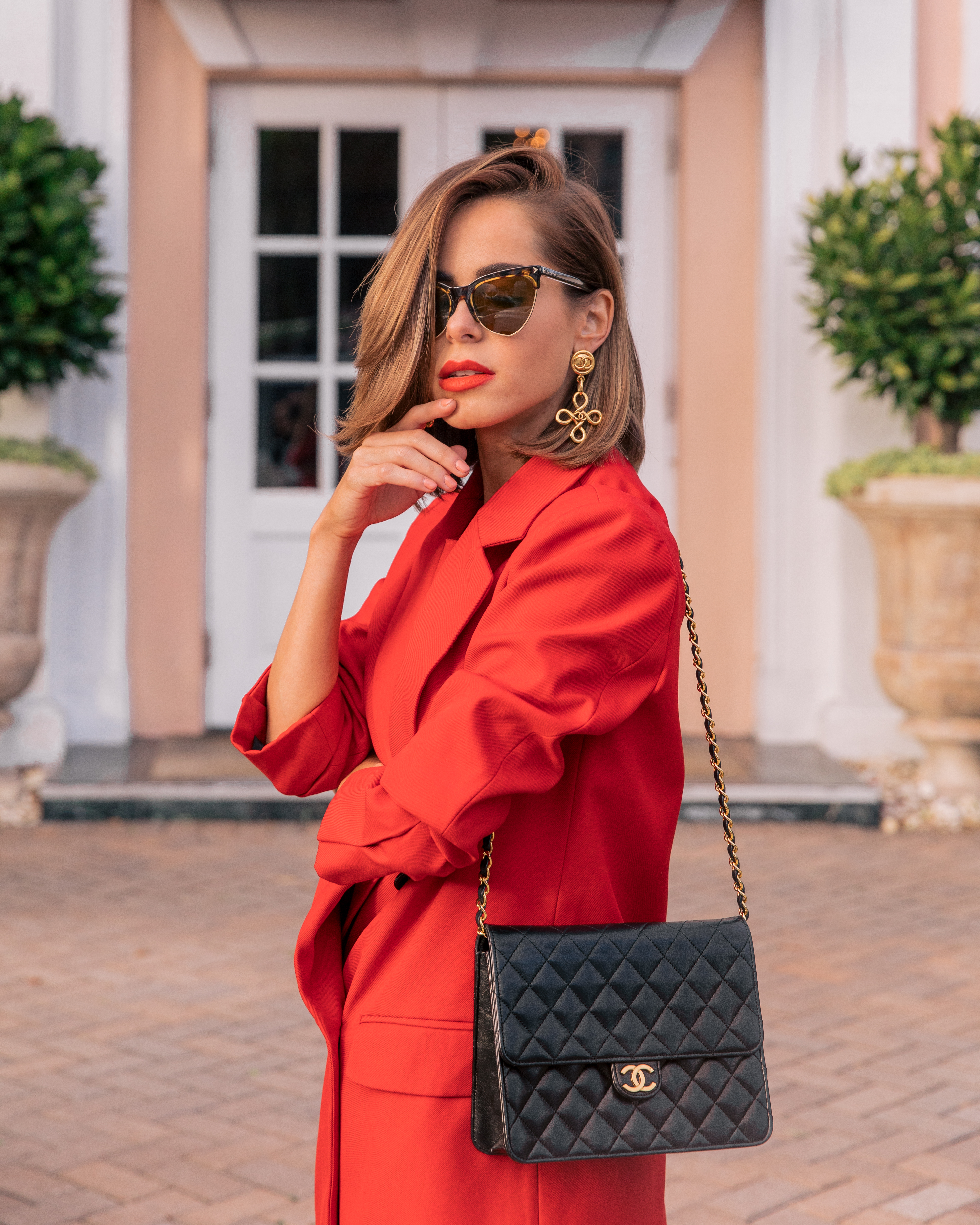 Style Blogger Stephanie Hill from The Style Bungalow wears an ootd featuring red and Chanel