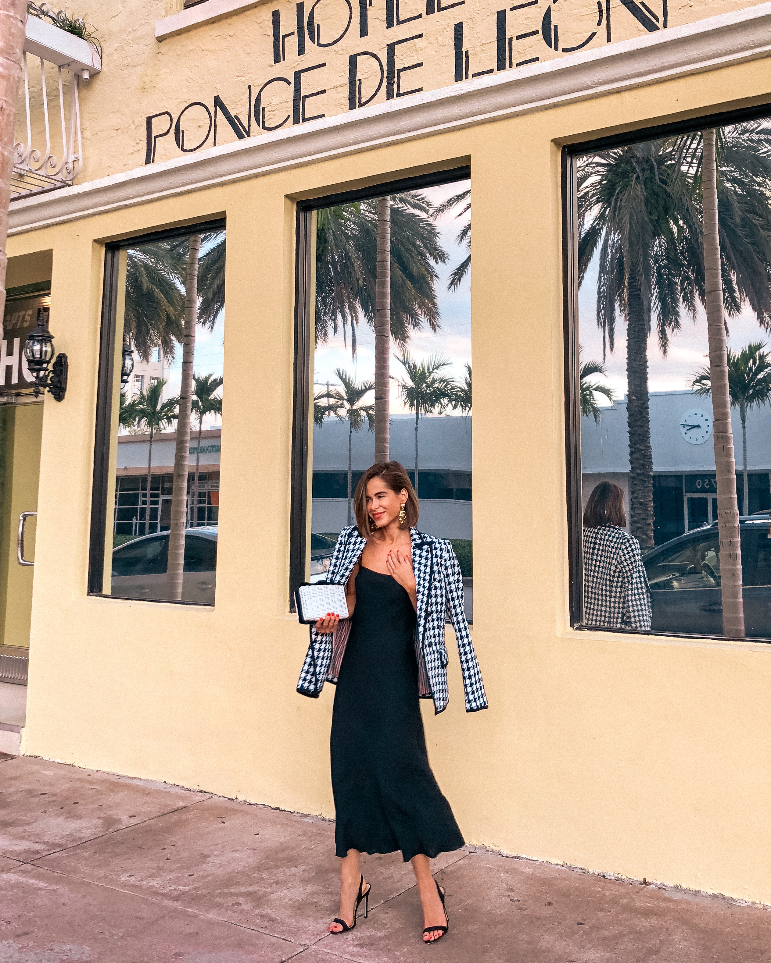 Stephanie Hill from The Style Bungalow wears ootd featuring Intermix blazer in Miami Beach