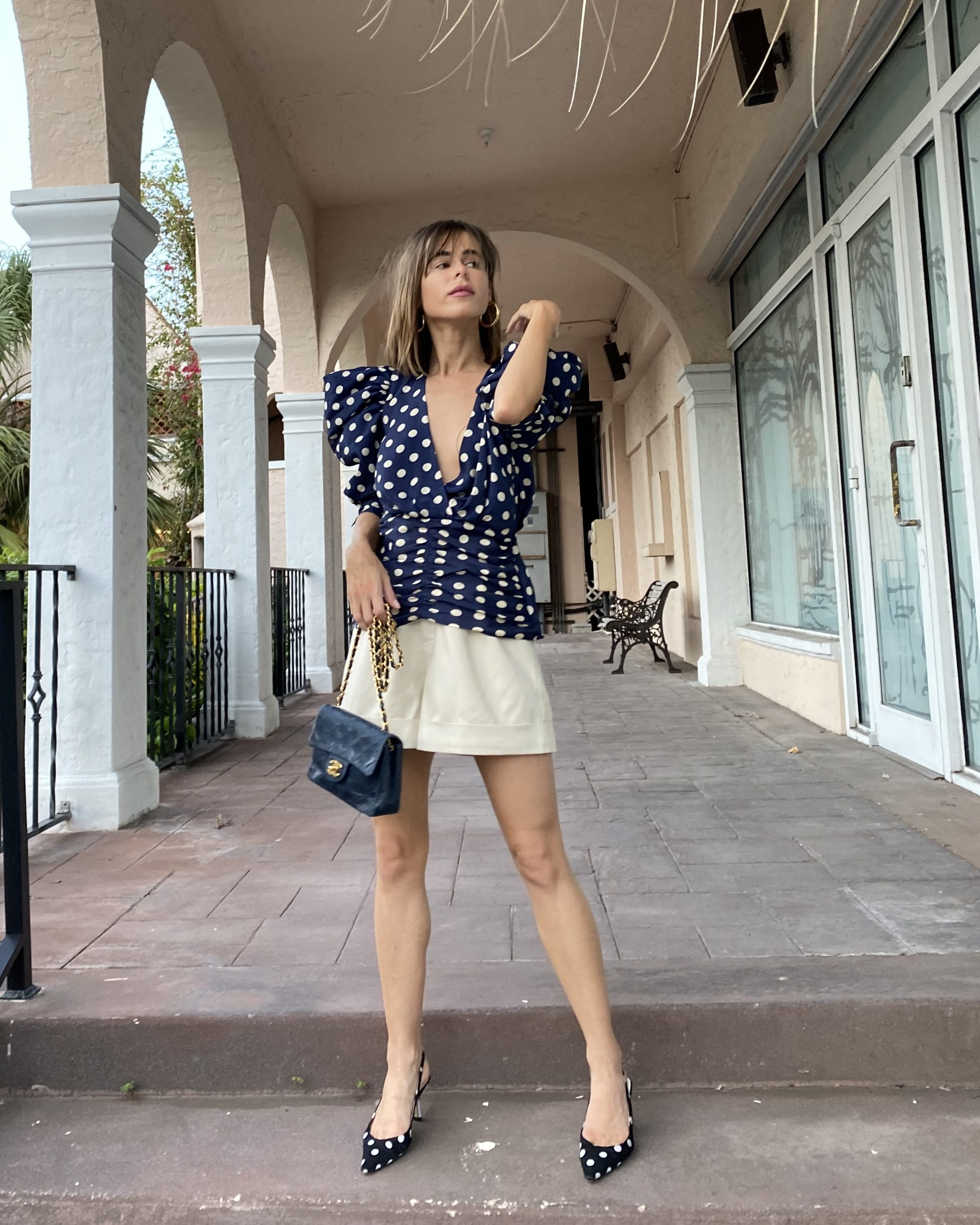Fashion Blogger Stephanie Hill wears #ootd featuring Ronny Kobo blouse on The Style Bungalow