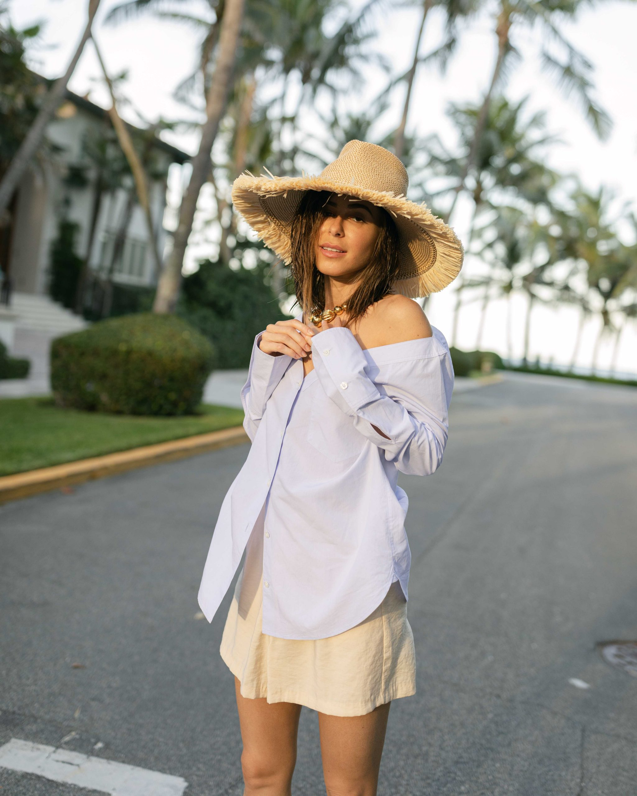 Style Blogger Stephanie Hill wears #ootd featuring an Eric Javits sun hat on The Style Bungalow