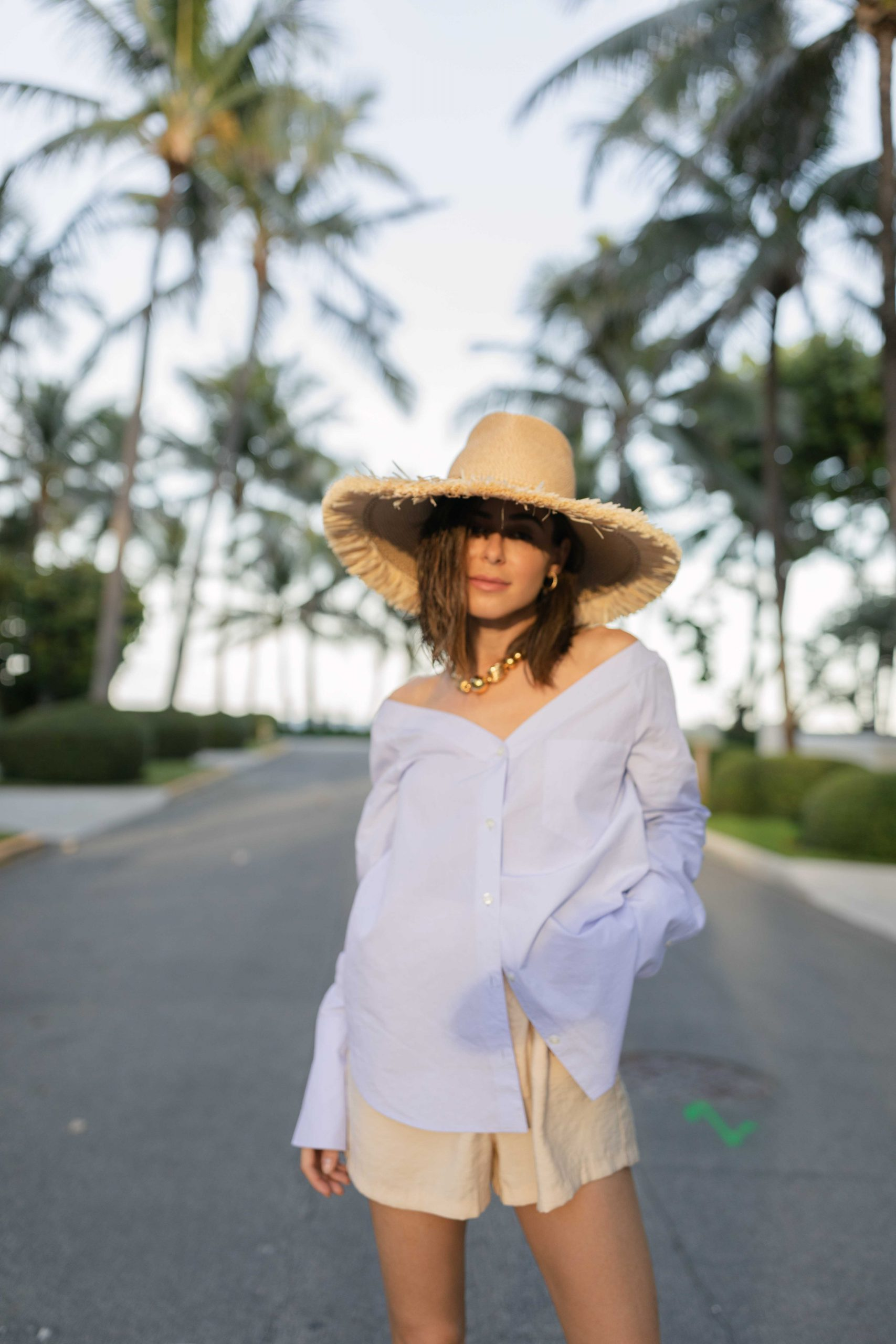Fashion Blogger Stephanie Hill wears #ootd featuring an Eric Javits sun hat on The Style Bungalow